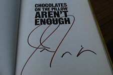 Chocolates on the Pillow Aren't Enough signed by Jonathan Tisch