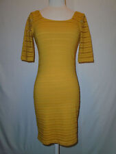 BEBE WOMANS YELLOW  CUT OUT DRESS SIZE X SMALL