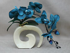 ARTIFICIAL SILK MOTH ORCHID IN TEAL WITH LEAVES IN CREAM FOSSIL VASE