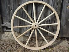 "Wagon Wheels For Sale. 48"" Tall. 2"" Wide. High quality wooden wagon wheels."