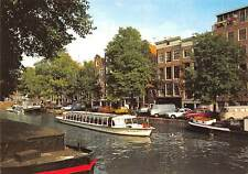 Netherlands Amsterdam Prinsengracht with Ann Frank House Vintage Cars Boat