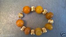 14K gold 7 beads and old egg yolk amber 7 beads Charm