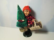 Byers Choice Retired 1991 Boy Cutting Christmas Tree with Cut Logs