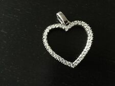 Silver Heart Shaped Pendant 9.25. Silver. Surrounded By Cubic Zirconia