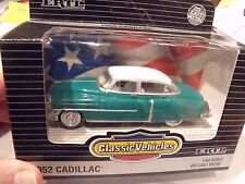 ERTL VINTAGE VEHICLES,1:43,#2541,1952 CADILLAC,WHITE/GREEN, NEW IN BOX