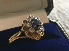 Diamond Cluster Ring with Dark Blue Sapphire on an 18ct Gold Shank