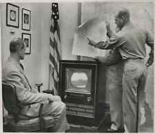 USA, Washington, Pentagon officers watch Maryland Maneuver on TV. Brig. Gen. S.P