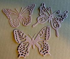 THREE FINELY DETAILED EXOTIC PALE LILAC PEARLESCENT BUTTERFLIES.