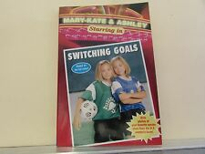 Mary-Kate & Ashley in Switching Goals with photos of favorite soccer players