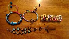 Lot of 4 Catholic Religious Beaded Bracelet Saints or crosses.