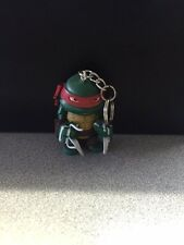 NICKELODEON 2015 TMNT RAPHAEL KEYCHAIN WITH ONE 3D CARD PUZZLE PIECE