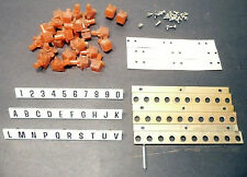 ROWE JAO part:  30 BUTTONS & 3 PLASTIC GRAPHIC STRIPS & support hardware