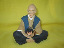Vintage Japanese HAKATA Man Figurine - Doll (Man holding pot)