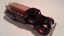 Modified and repainted 1930s Dodge Airflow into an open HEARSE with coffin
