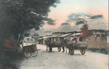 g899. Vintage 1913 Handcolored Postcard Japan Horse Drawn Carts & Thatched Huts