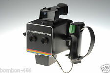 POLAROID INSTANT MINIPORTRA CAMARA. MODEL 202. USED -TESTED- GUARANTEED. NO BACK