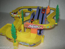 UNIQUE- 4 CARS TRACK RACER SET - BATTERY OPERATED WITH MUSIC & FLYING HELICOPTER