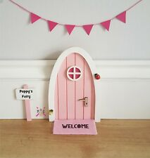 Pink Fairy door with personalised signpost and miniature hot pink bunting