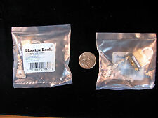 2 Master Locks No 12 Small Brass lock keyed  alike for Tool box's , Gun case,ect