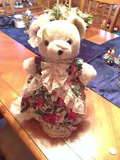 Cute teddy bear on a stand, wearing a lacy, flowered dress--for bear lovers!