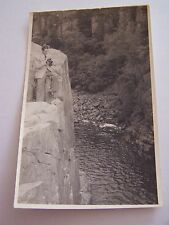 Vintage Photo Man Standing on Edge of Cliff Holding a Camera River Below 1955