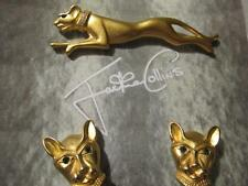 Vintage Signed Jackie Collins Panther gold tone pin and clip-on earrings