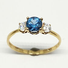 14K solid yellow gold 5mm blue Topaz round faceted white Topaz ring, size 7