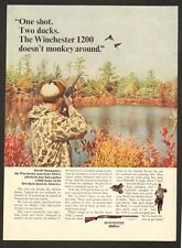 Vintage 1966 ad 1027 for Winchester 1200 Pump Auction Shotgun  - ad only