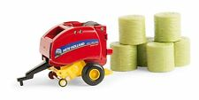 1/64 ERTL NEW HOLLAND 560 BIG ROUND BALER W/ BALES