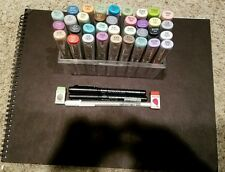 35 Copic markers, mangaka 01 and 08 markers, a gellyroll 08 marker, and notebook