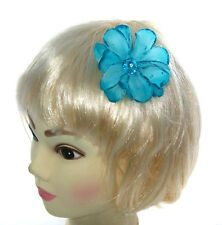 small blue hair flower with gem center on a small clip