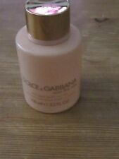 empty Dolce Gabbana body cream bottle