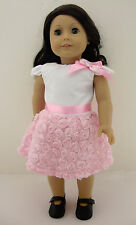 A Cute White and Pink Summer Dress with Rosettes on Skirt Complete with Black Sh