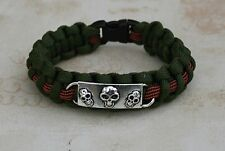 Para Cord Bracelet and three silver tone skulls with slide catch