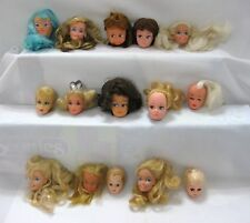LOT OF FIFTEEN DOLL HEADS...MOSTLY BARBIE...