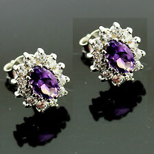 Sterling Silver Oval Amethyst Earrings Surrounded By Cubic Zirconias