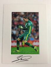 (3) An 8 x 6 inch mount with photo signed by Maarten Stekelenburg of Everton