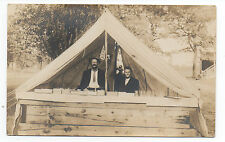 1910 RPPC Postcard of Two Men behind makeshift Concession Stand