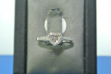 Women's 14k white gold heart set baguette and round diamond engagement ring
