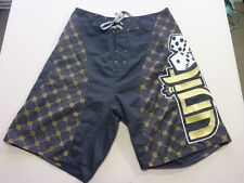 116 MENS EX-COND UNIT BLACK / GOLD / WHITE PATTERNED BOARDSHORTS 30 $80 RRP.