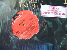 "Level 42 ""Something About You"" (Remix) 7.38 & Instr. 7.00. 12"" Single In V/G+."