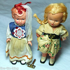 PAIR VINTAGE TOY GIRL DOLLS C1950-60S CLOCKWORK WIND-UP GERMAN FOLK DRESS