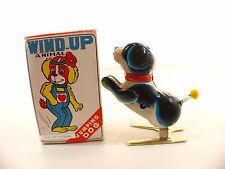 Fa Tiao China Tin toy JUMPING dog Action Wind-Up  moteur clé en boite