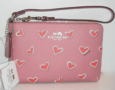COACH HEART PRINT COATED CANVAS WRISTLET CORNER ZIP ROSE PINK RED HEARTS F65571