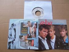 AHA,TAKE ON ME/LOVE IS REASON single vg+/m- FOC + 2 extra Seiten , warner bros.