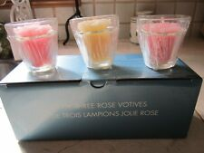 NEW IN BOX AVON SET OF THREE VOTIVES  AND  FLOWER CANDLES GREAT GIFT