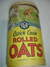 Antique Quick Cook Rolled Oats IGA Container with lid.