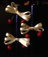 One hair clip with cherries. ribbon bow. Rockabilly. Punk. Emo.
