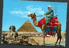 View of a Man on a Camel in front of the Sphinx & Khefren Pyramid. Dated 1976