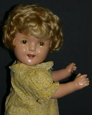 SHIRLEY  TEMPLE  VINTAGE  COMPOSITION  DOLL  WITH  YELLOW  FLORAL  PRINT  DRESS